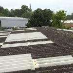 Asbestos over cladding